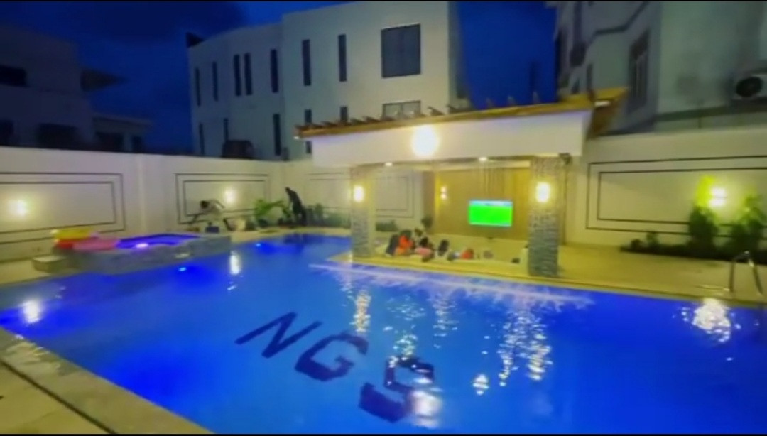 Jude Okoye shows off massive pool in his home, with a side pool for the kids and a lounge area (video)