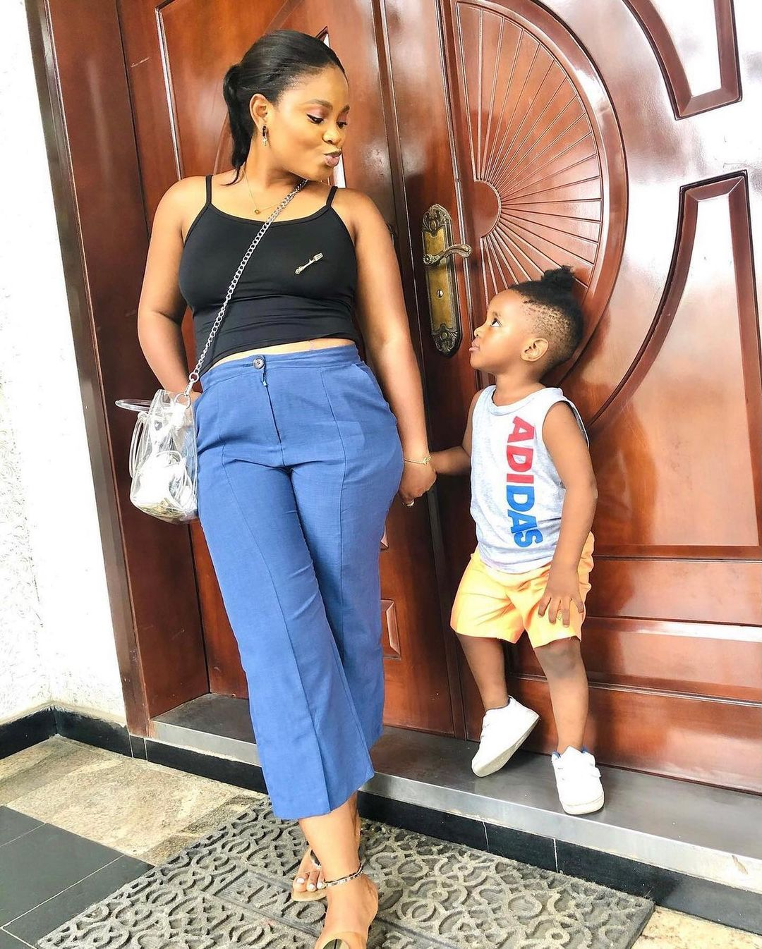 photos of Tega with her husband and son